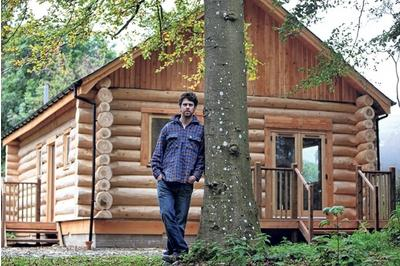 Chris outside the recently completed Whitchesters Cabin